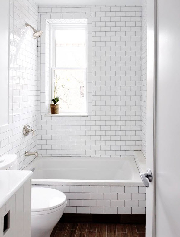 Beautiful tile bathroom with white bathtub