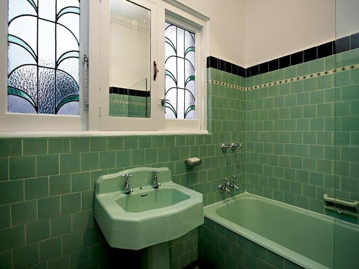 Amazing Bathroom With White Vanity And Green Glass Tiles