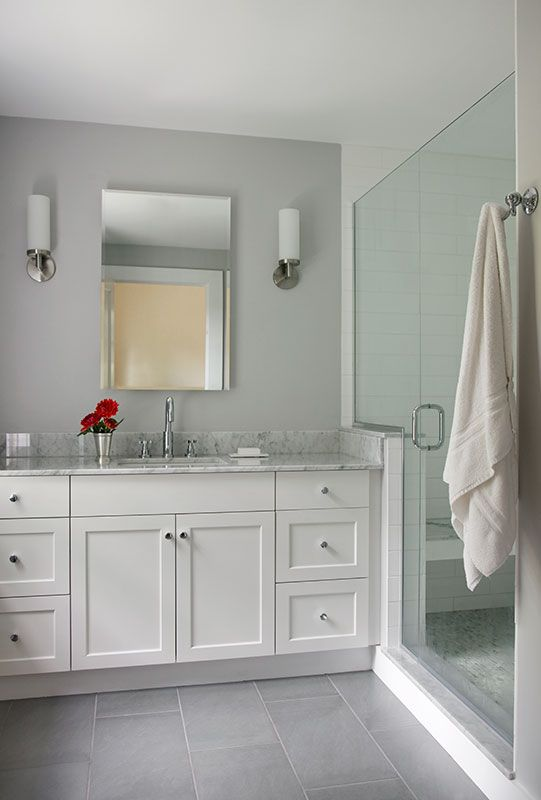 Beautiful Stunning Bathroom Features An Arched Alcove Filled With An Oval Freestanding Tub And A Floor Mount Tub Filler Flanked By Polished Nickel Floor Lamps Placed Under A Window Dressed In Sheet Curtains Atop A White And Gray Marble Tiled Floor