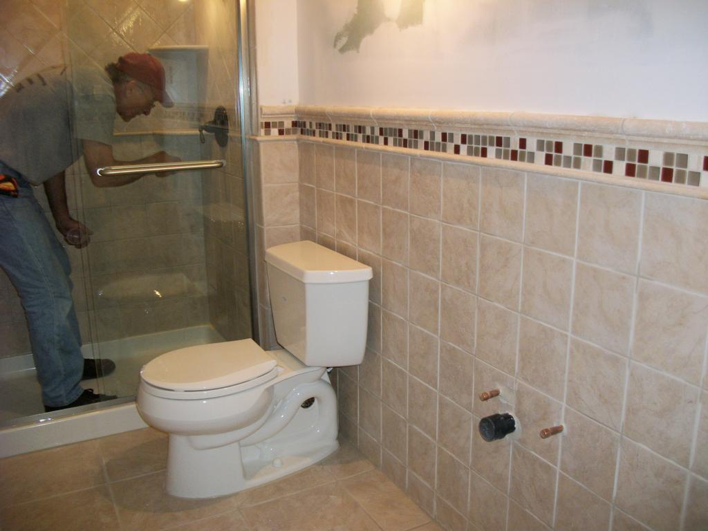 4 handful pictures about laying ceramic tile in bathroom for Tiled bathroom designs pictures