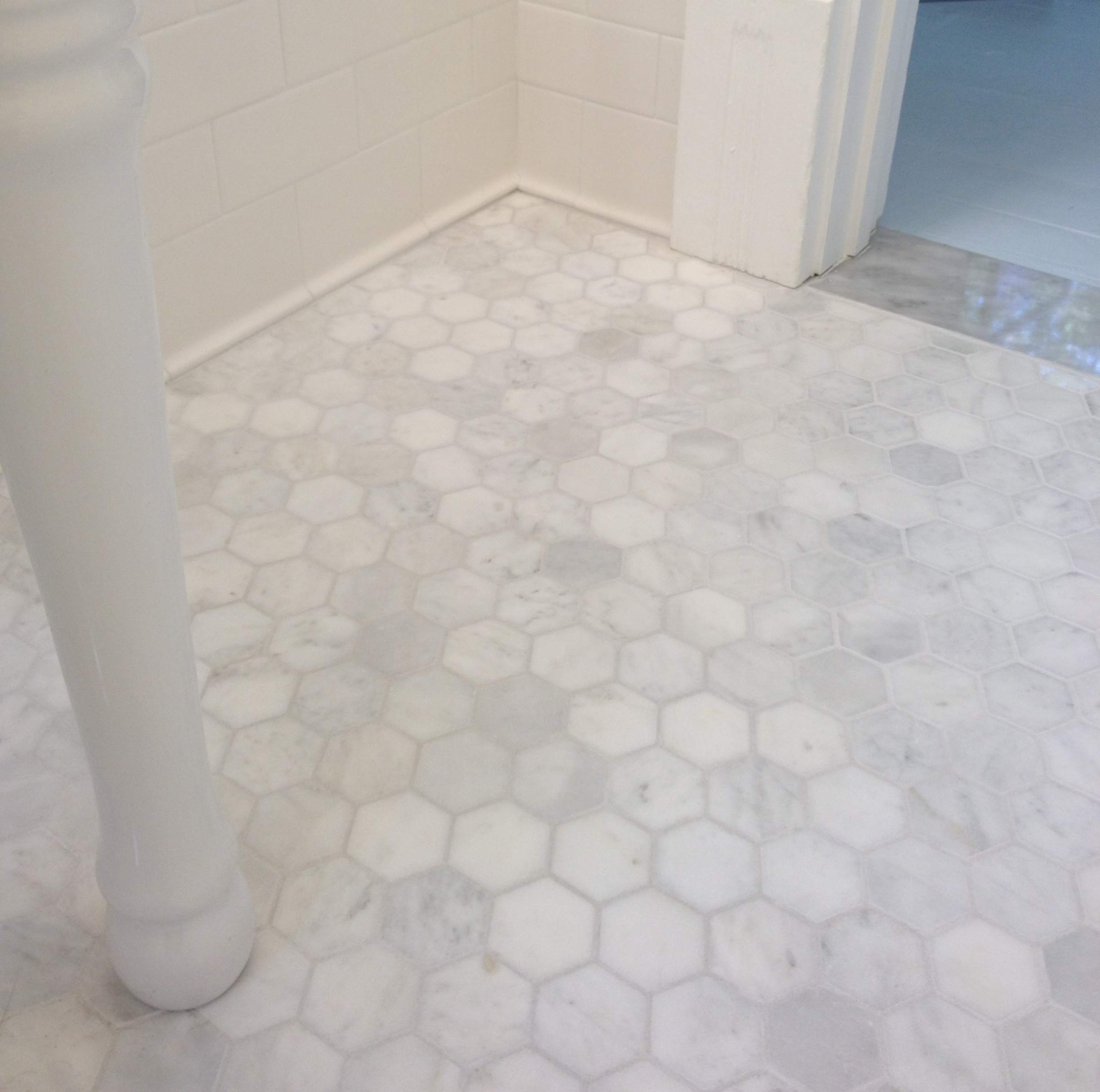 11 - White Marble Tile Bathroom