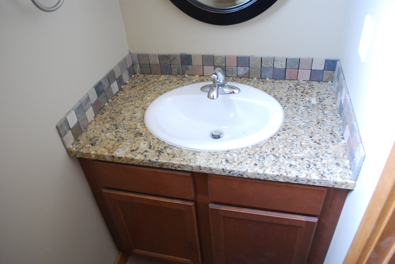 26 - Glass Tile Backsplash In Bathroom