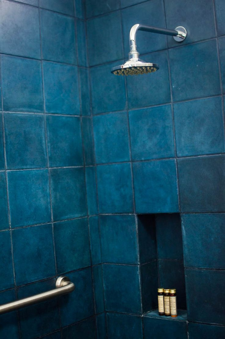 White Bathroom Tiles Turning Blue