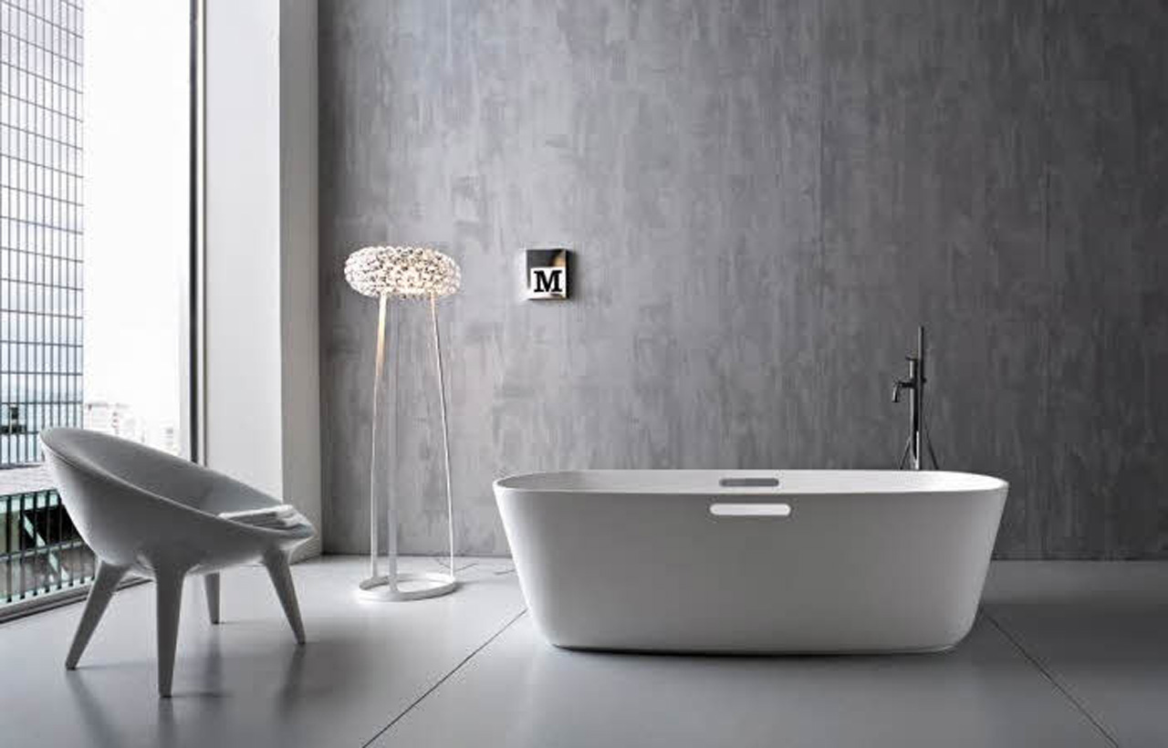 Minimalist-Modern-Bathroom-Interior-Idea-with-White-Freestanding-Bathtub-and-Tub-Filler-and-Gray-Wall-Paint-Color-and-Floor-Tile-also-Unique-Floor-Lamp-and-Round-Shaped-Chair