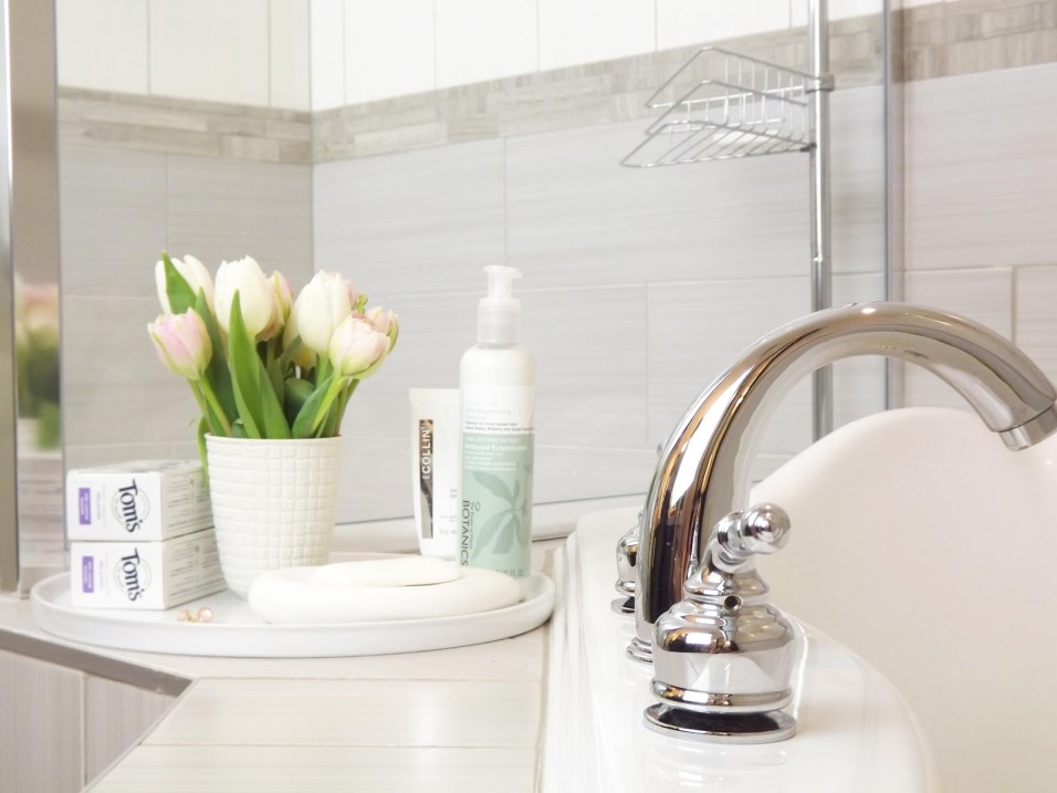 bathroom-decorations-scenic-stainless-steel-unique-mixer-taps-on-white-porcelain-washbasin-with-white-tulips-flowers-vase-and-liquid-soap-as-well-as-sweet-grey-wall-tiles-bath-and-free-standing-