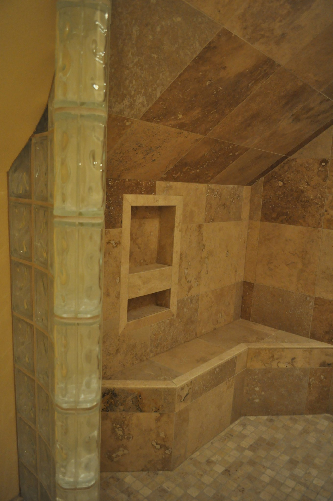 bathroom-niche-travertine-heated-bench-glass-block-wall-quality-remodeling-specialists-Jake-Ruiz-jpg