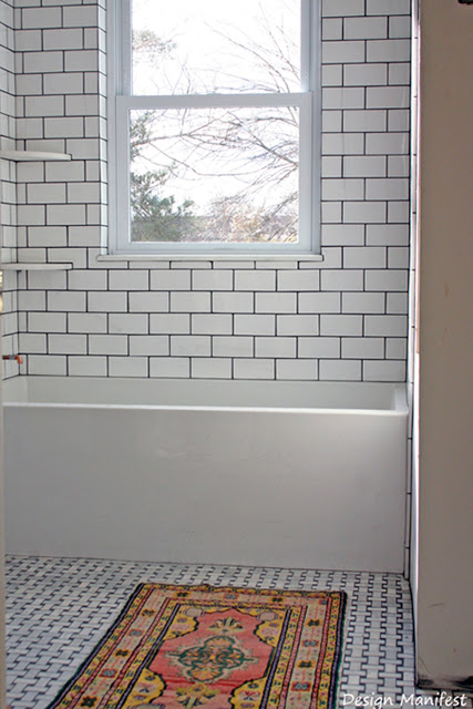 bathroom+tiled+with+rug+design+manifest1