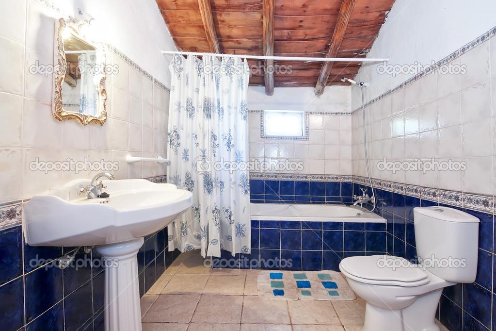 Vintage retro bathroom. Blue tiles.
