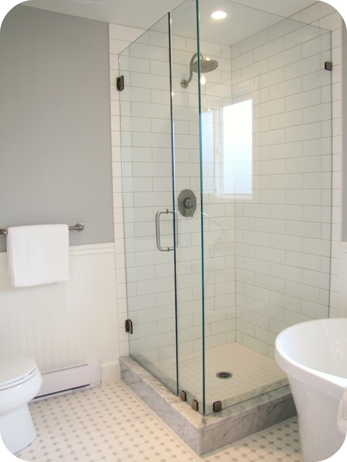 interior-bathroom-modern-clear-glass-cubicle-white-tile-shower-room-paneling-with-stainless-steel-wall-mount-waterflall-shower-designs-with-glass-tile
