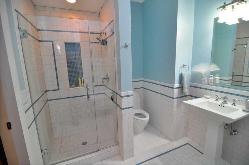 the-bathroom-wall-tile-ideas-for-your-bathrooms-with-light-blue-towel