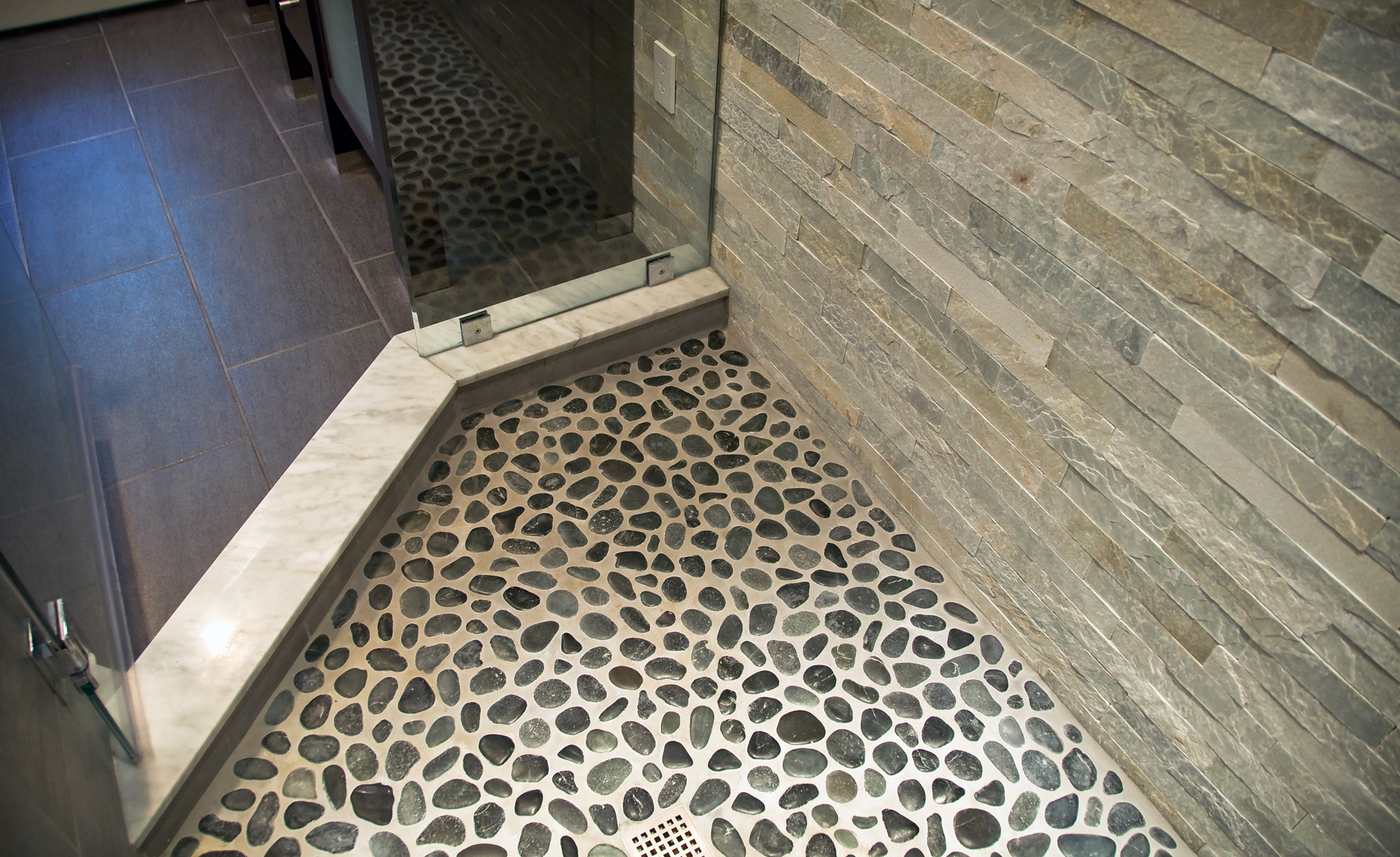 31 great ideas and pictures of river rock tiles for the for Shower floor tile