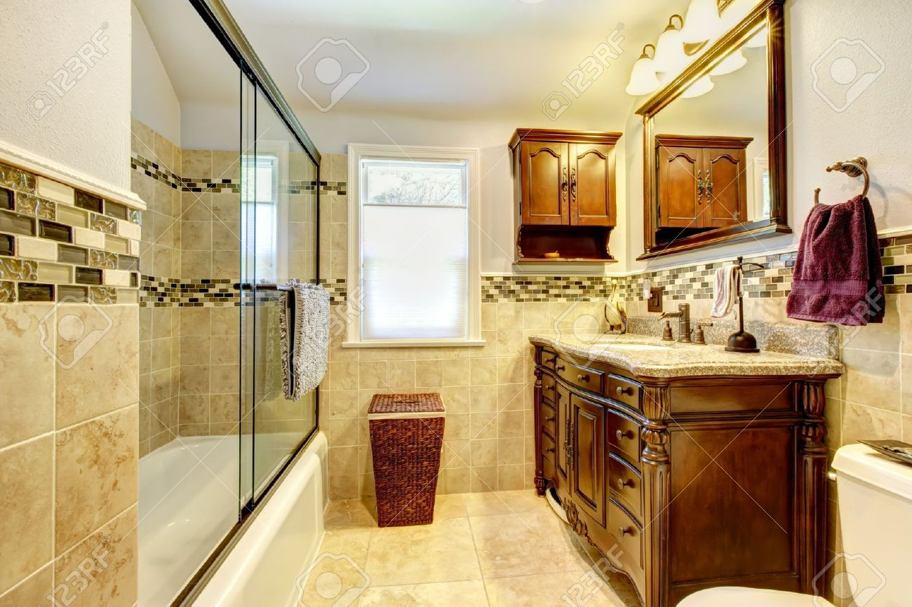 14615038-Classic-bathroom-with-natural-stone-tiles-and-wood-cabinet--Stock-Photo