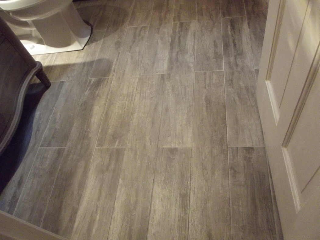 28 great ideas and pictures of faux wood tile in bathroom for Bathroom floor ceramic tile designs