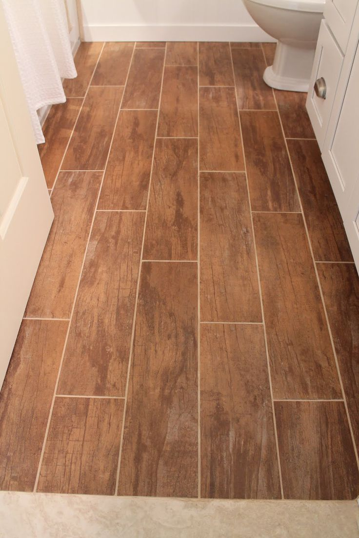 27 ideas and pictures of wood or tile baseboard in bathroom for Tile and hardwood floor