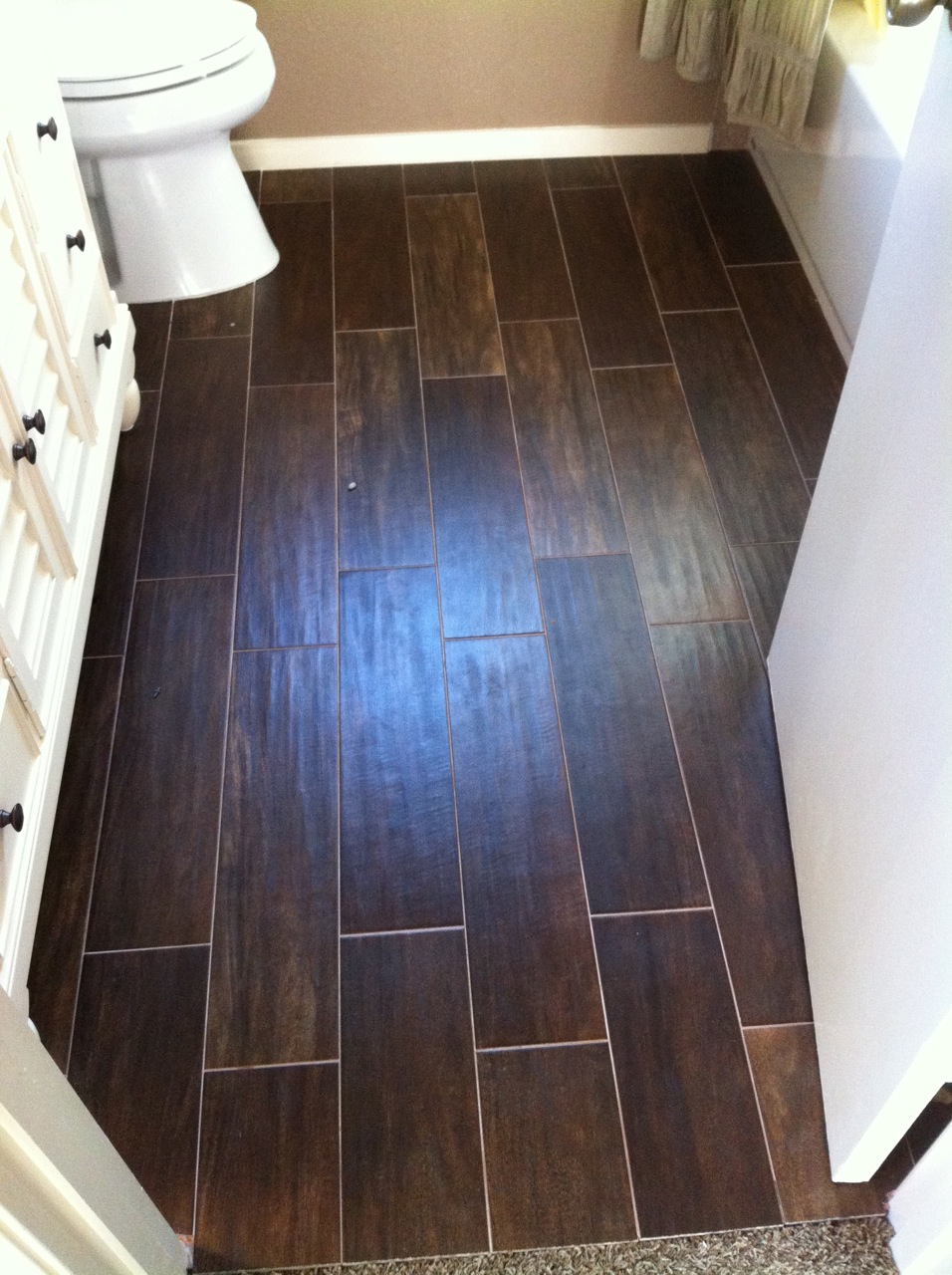 25 pictures and ideas of wood effect bathroom floor tile for Wood floor bathroom