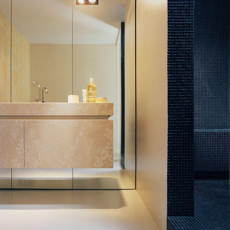 5e169__Dark-tiles-shape-the-shower-area-in-the-cozy-bathroom