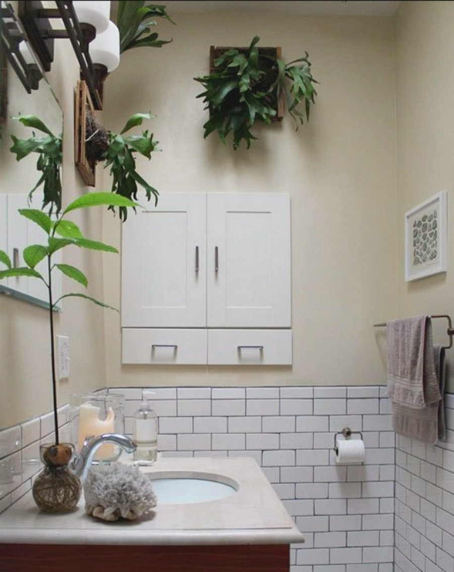 Vintage-Echo-Park-bathroom-with-white-tile-wall-coupled-with-fabulous-Elkhorn-Fern-and-a-tall-potted-plant-on-the-vanity