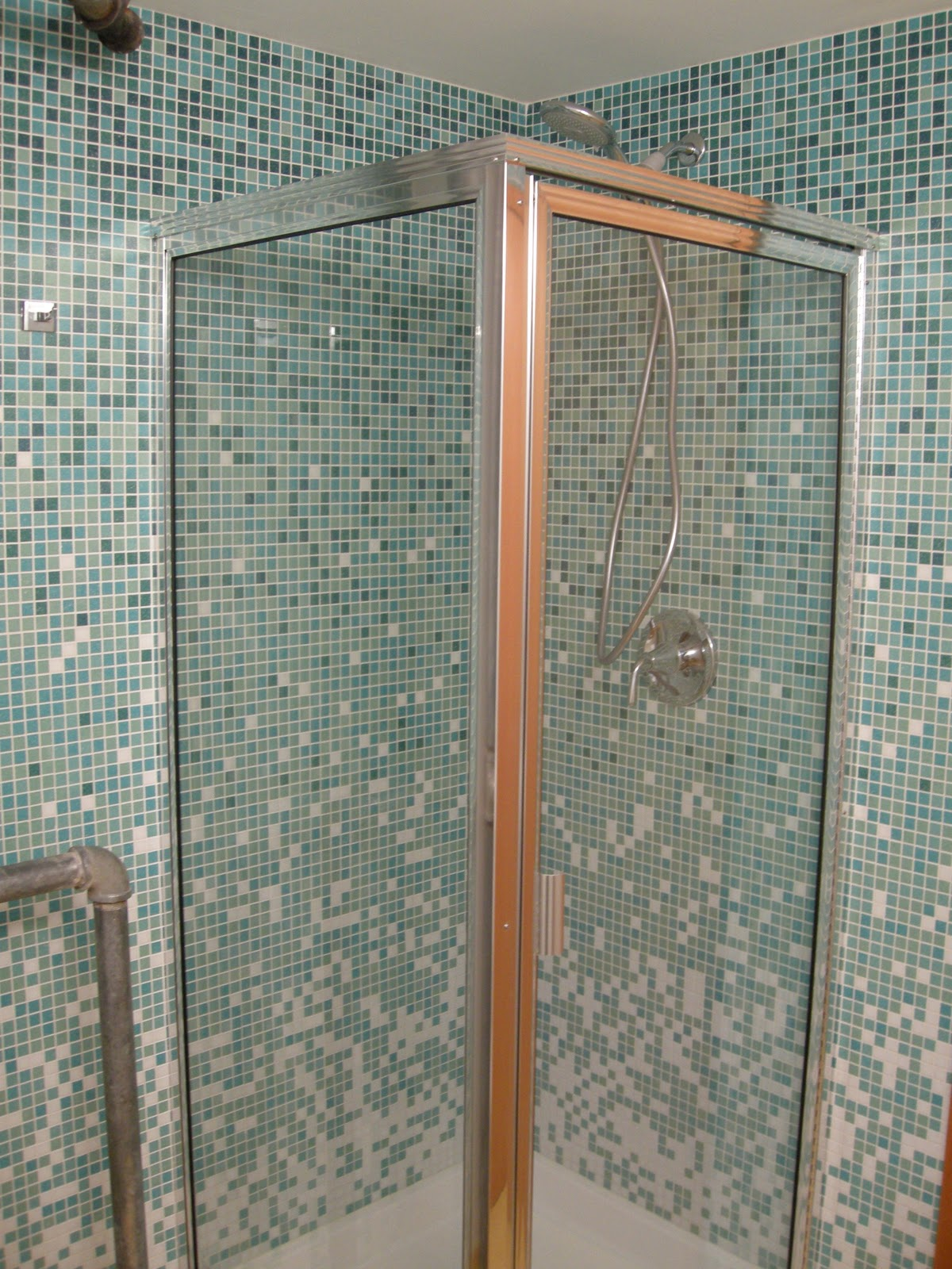 bathroom-inspiration-cool-blue-mosaic-wall-tiled-in-modern-small-space-bathroom-decors-with-amazing-showers-wall-as-well-as-glass-shower-cubicle-ideas-amazing-showers-and-tubs-astonishing-ideas-and-a