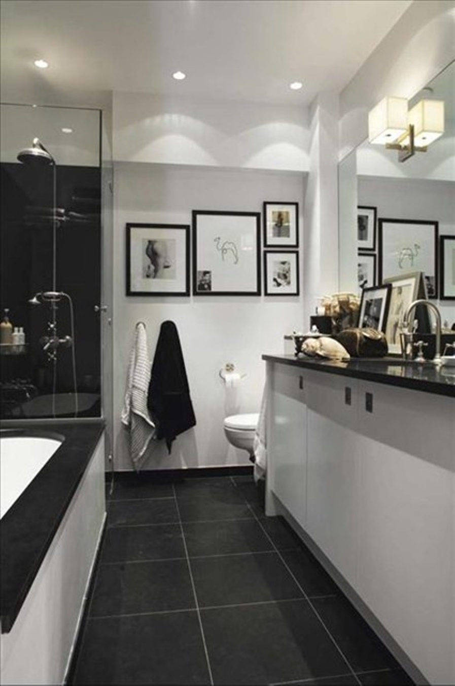 bathroom-with-dark-floor-tiles-and-white-walls-and-recessed-bathroom-lighting-fixtures-in-the-ceiling-with-black-and-white-sink-vanity
