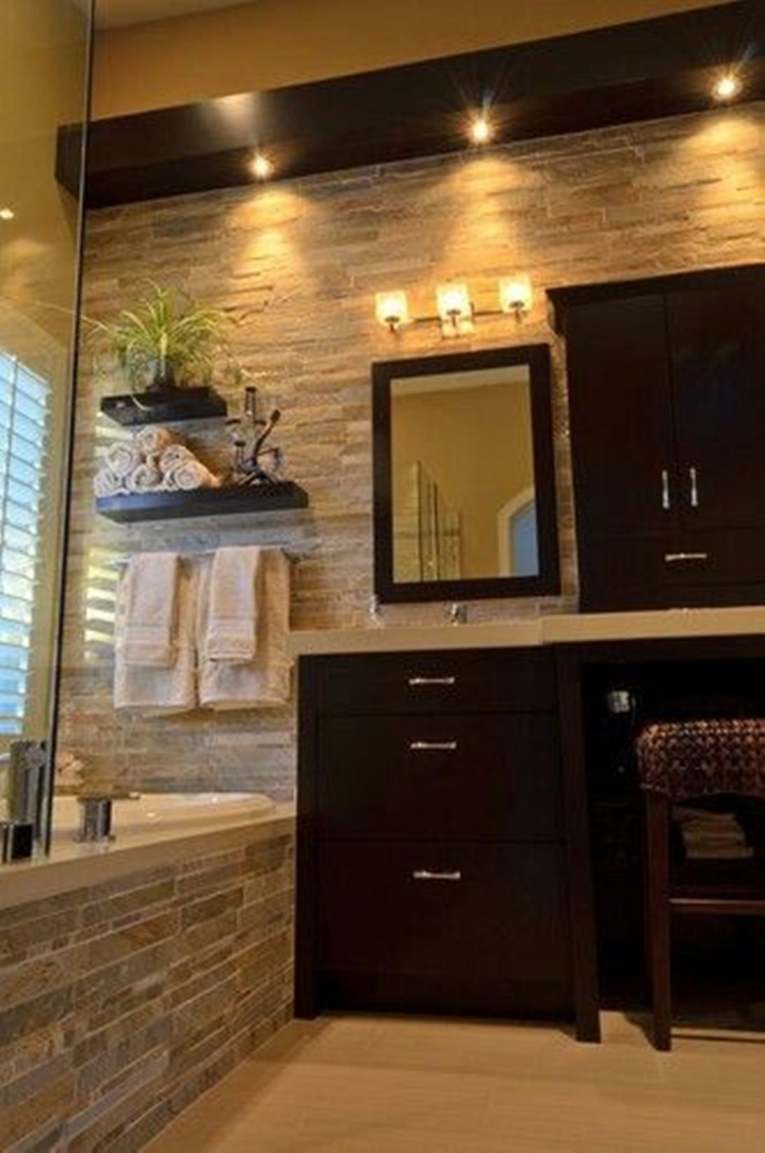 cool-bathroom-with-natural-stone-bathroom-tiles-and-dark-wood-vanity-and-recessed-bathroom-lighting-fixtures