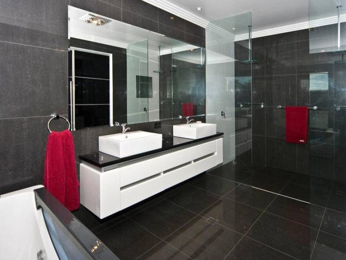 cool-brown-bathroom-tile-idea-with-awesome-white-vanity-set-between-glass-room-divider-also-ring-stainless-steel-towel-shelf