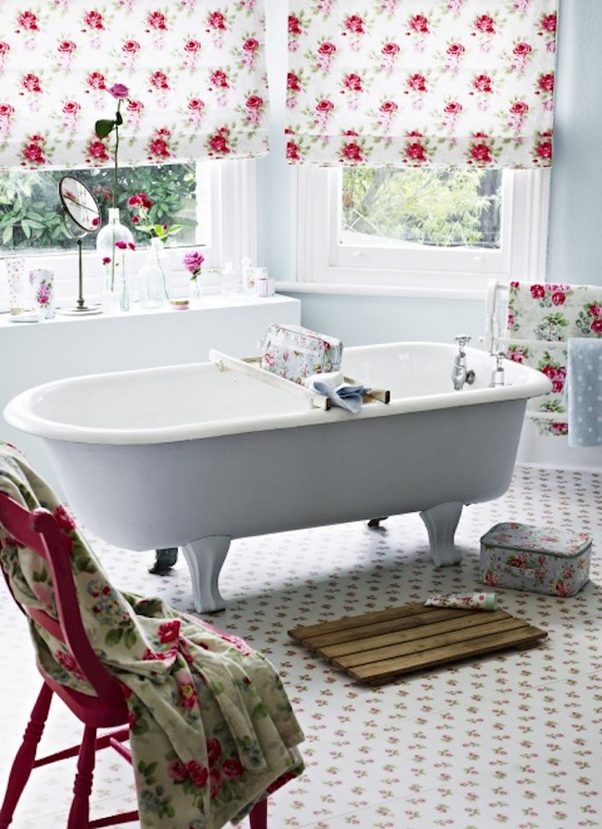 eclectic-bathroom-with-white-standalone-bathtub-and-vintage-red-chair-also-floral-curtain-and-floor-tile