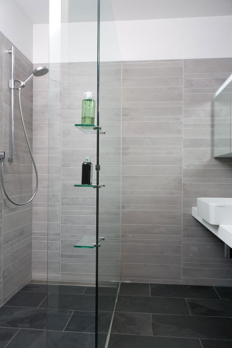 floor-interior-bathroom-decoration-furniture-cool-grey-natural-stone-for-shower-tile-wall-and-frameless-glass-shower-door-along-with-wall-mounted-chrome-shower-head-and-white-wooden-bath-vanity-moder