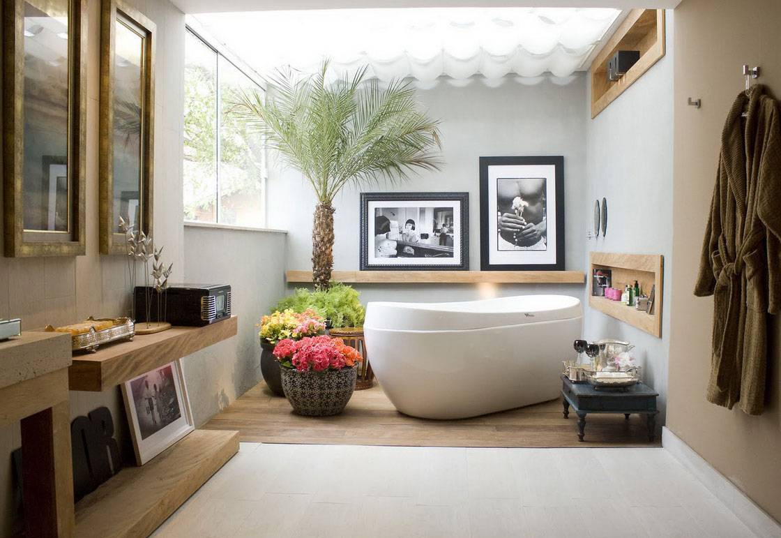 interior-bathroom-design-with-glass-roof-over-free-standing-tub-and-built-in-shelves-with-open-shelf-with-min-palm-tree-and-flower-pots