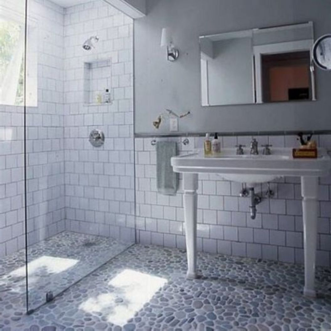 old-style-subway-tile-bathroom-in-shower-with-modern-glass-door-and-wall-and-pebble-floor