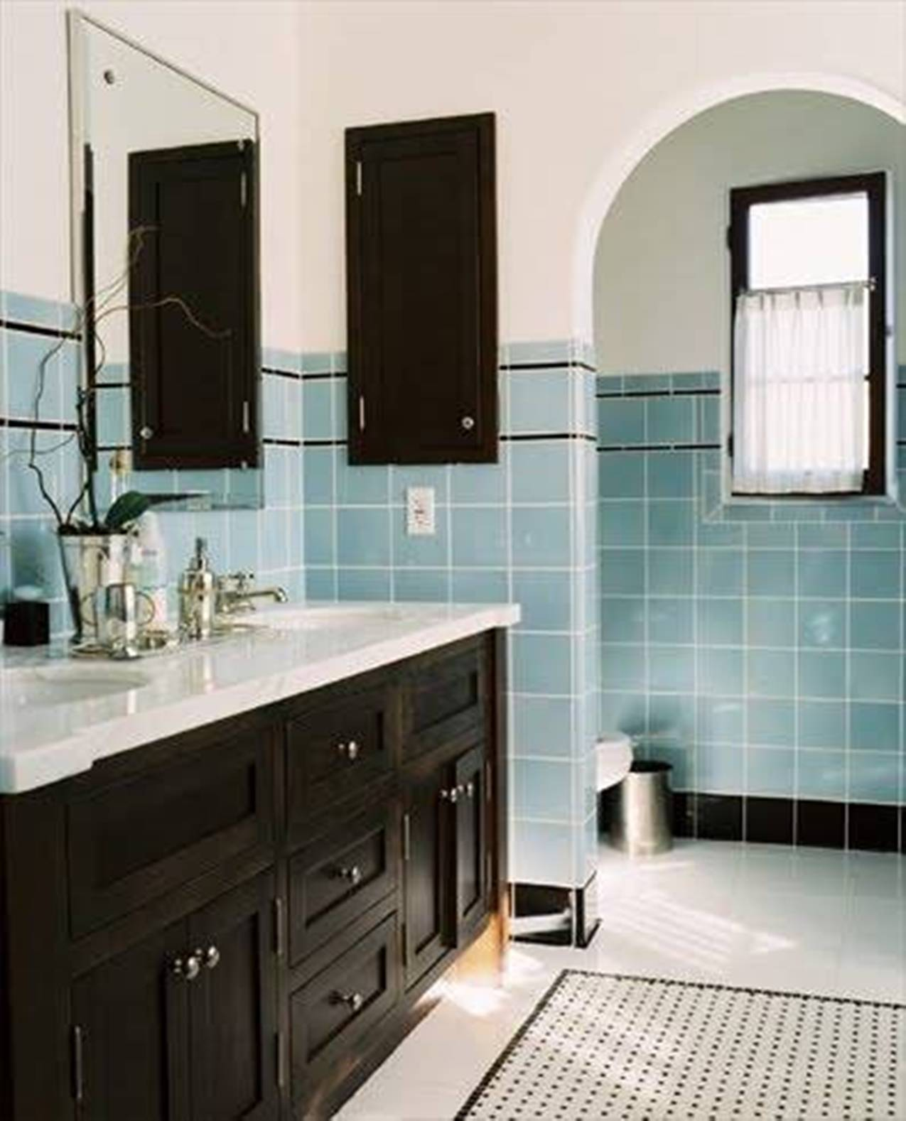 retro-bathroom-with-blue-and-black-tiles-and-wooden-vanity