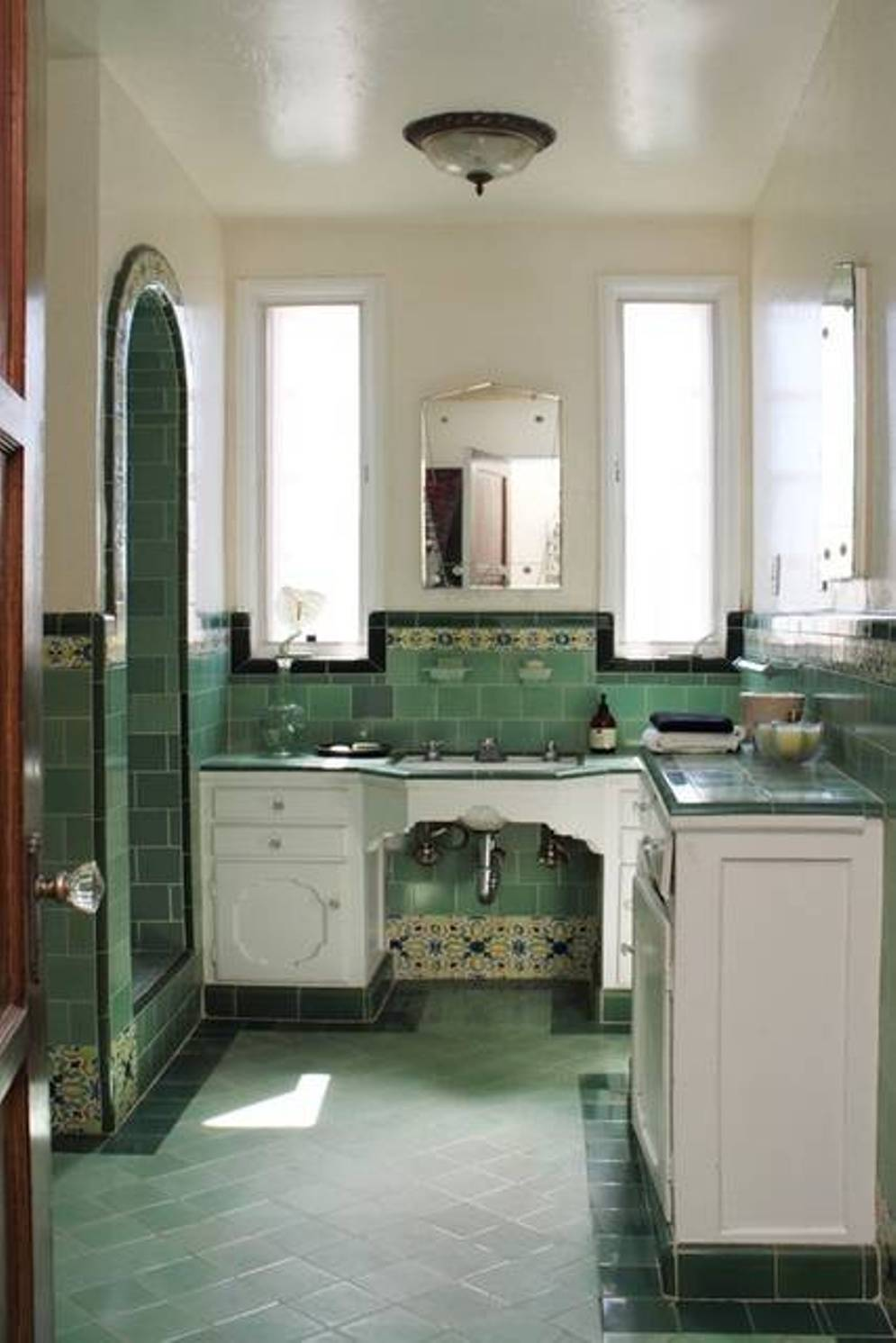 retro-bathroom-with-green-tiles-and-whote-vanity-cabinets