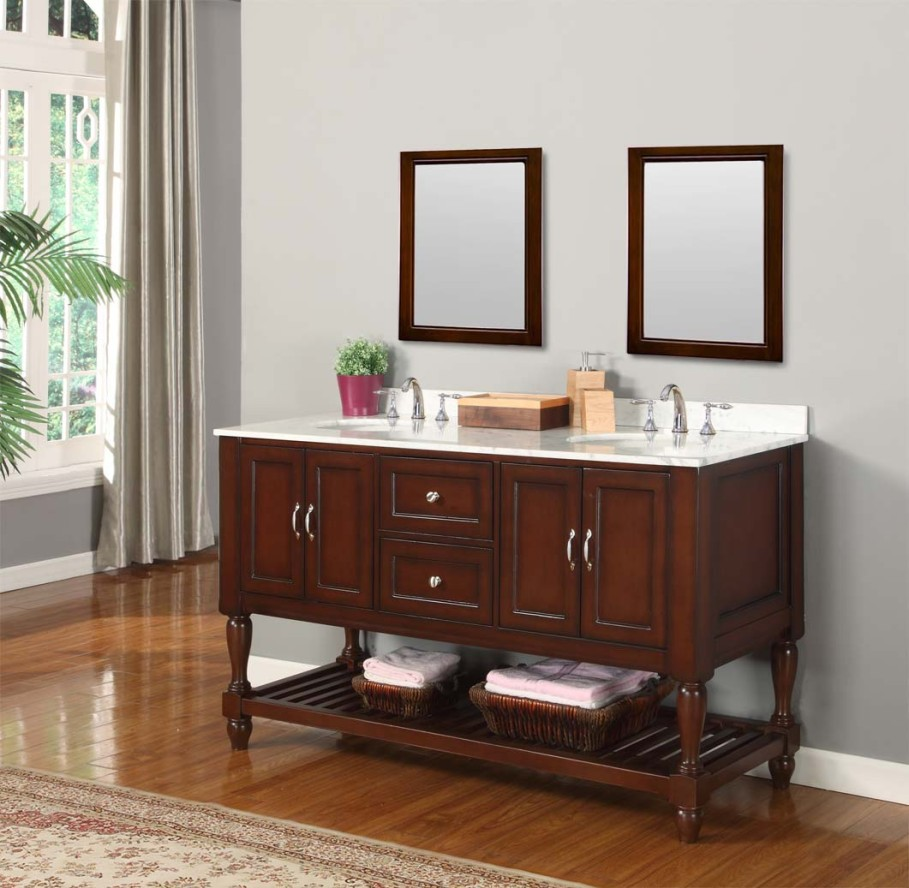 traditional-bathroom-vanities-with-tops-design-on-white-marble-material-below-double-mirrors-909x888