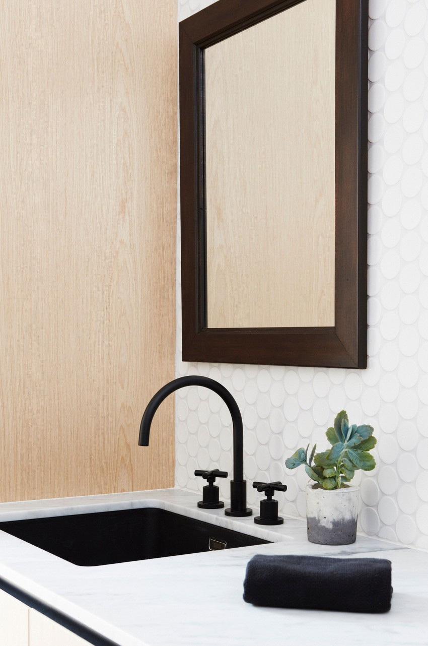 vintage-ikea-bathroom-wood-frame-mirror-white-polka-dots-tile-backsplash-black-undermount-basin