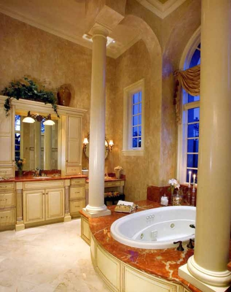 MaterialsTuscan style bathroom remodeling calls for natural stone, wood, and wrought iron.Marble or slate can be used on the floor and vanity top.A Tuscan bathroom often has eye-catching architectural elements such as arched window frames, niches, tall windows, skylights or columns.Then there is the glossier Tuscan look, which might feature terracotta tile floors, mottled marble finishes and designer hardware on drawers and cabinets.WarningMarble and stone tile look gorgeous in a Tuscan bathroom, but are also extremely slippery when wet.