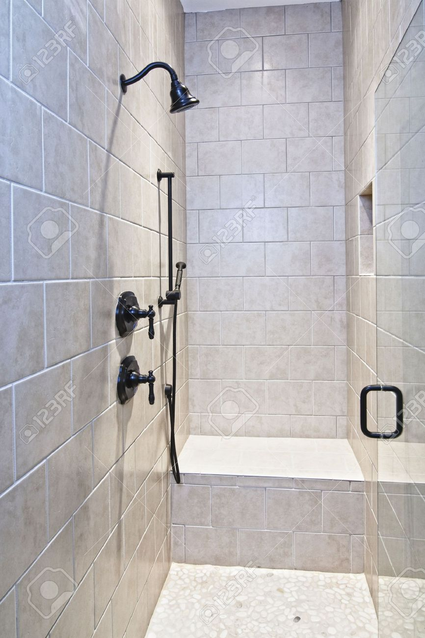 6341908-luxury-shower-with-bench-and-pebble-floor-Stock-Photo-shower-bathroom-tile