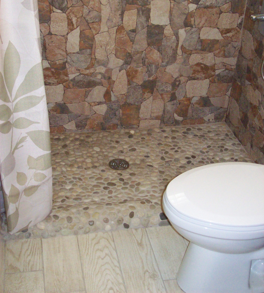25 interesting pictures of pebble tile ideas for bathroom for Granite and tile bathroom ideas