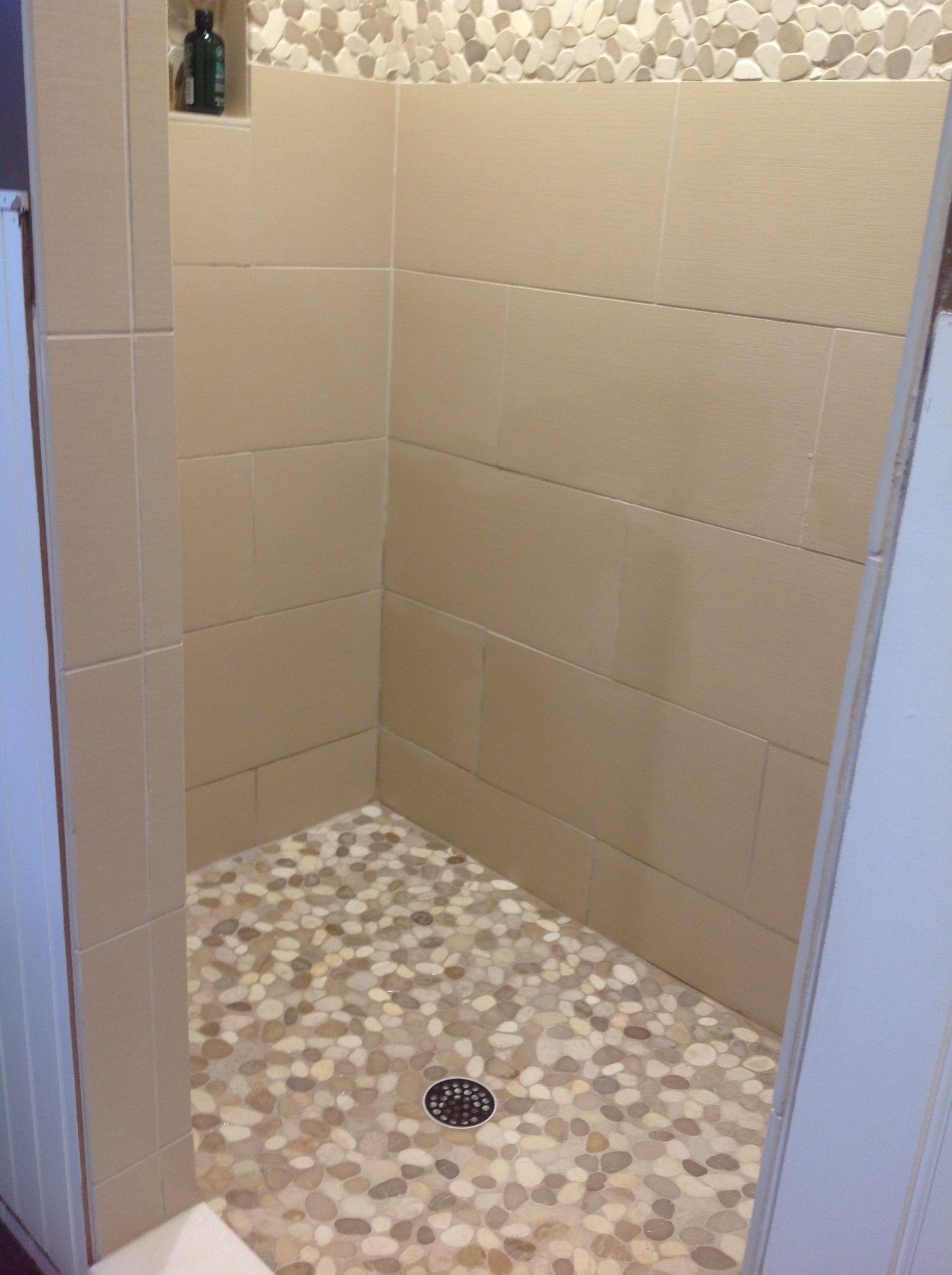 Sliced-Tan-and-White-Pebble-Tile-Shower-Flooring