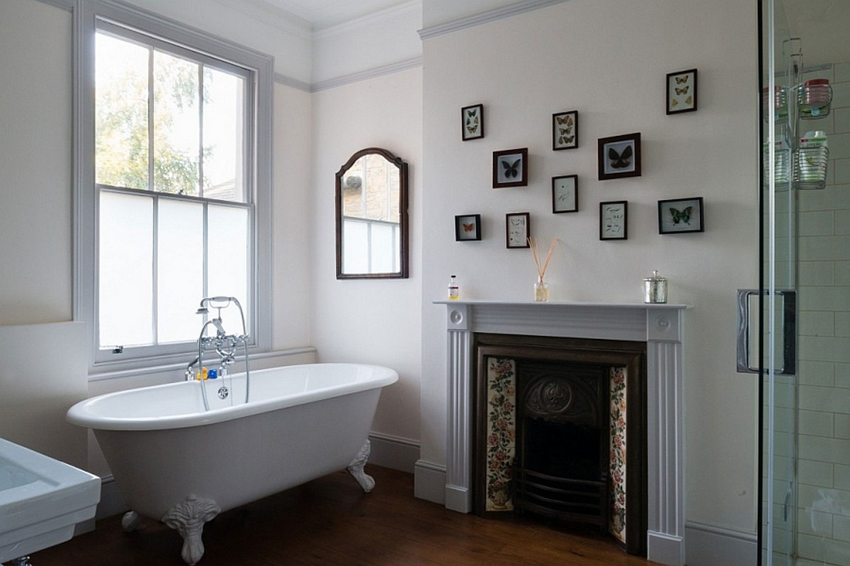 antique-fireplace-mantel-idea-feat-beautiful-clawfoot-bathtub-design-and-wooden-bathroom-floor-tile