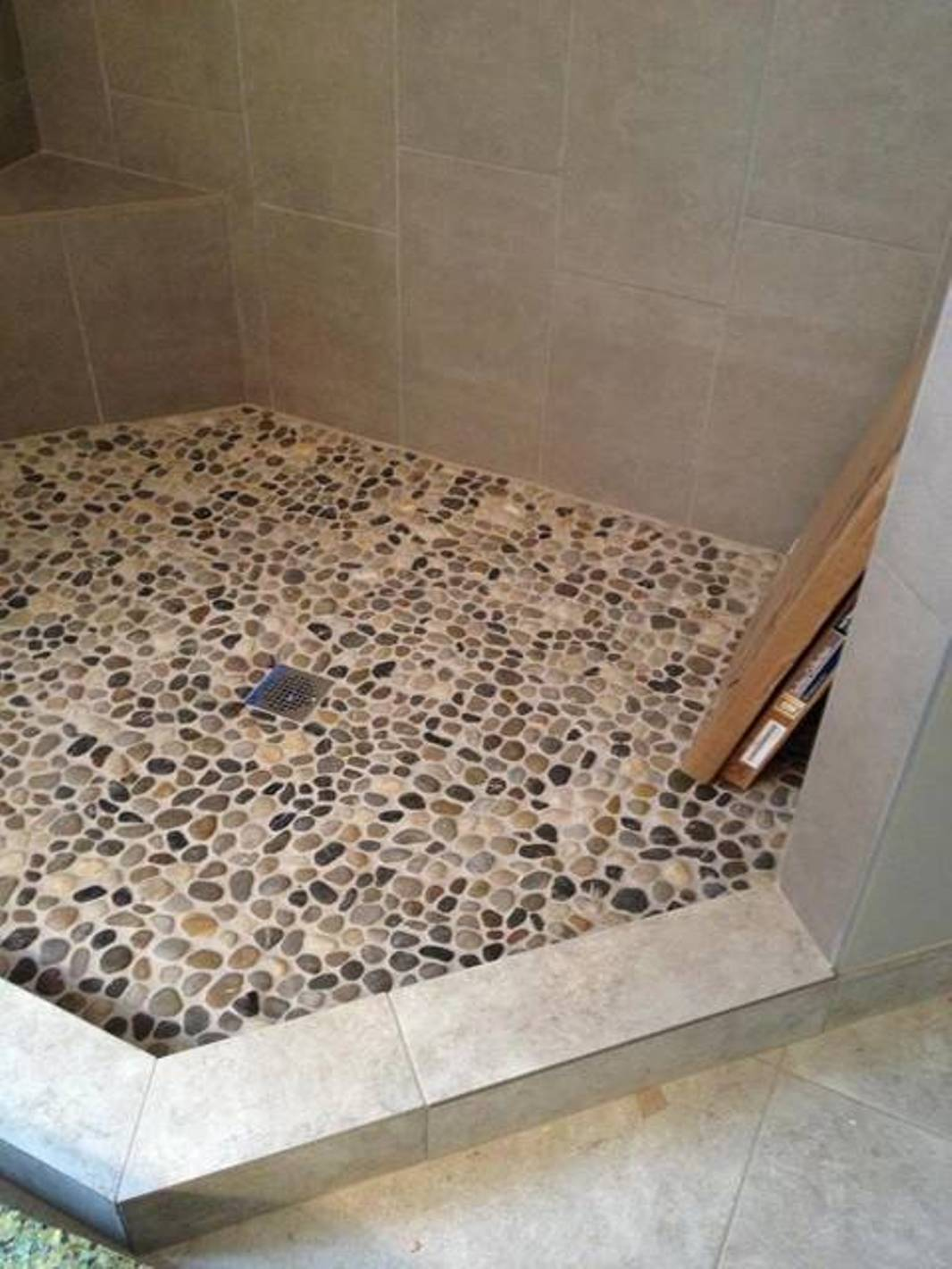 26 nice pictures and ideas of pebble bath tiles for Tile floors bathroom
