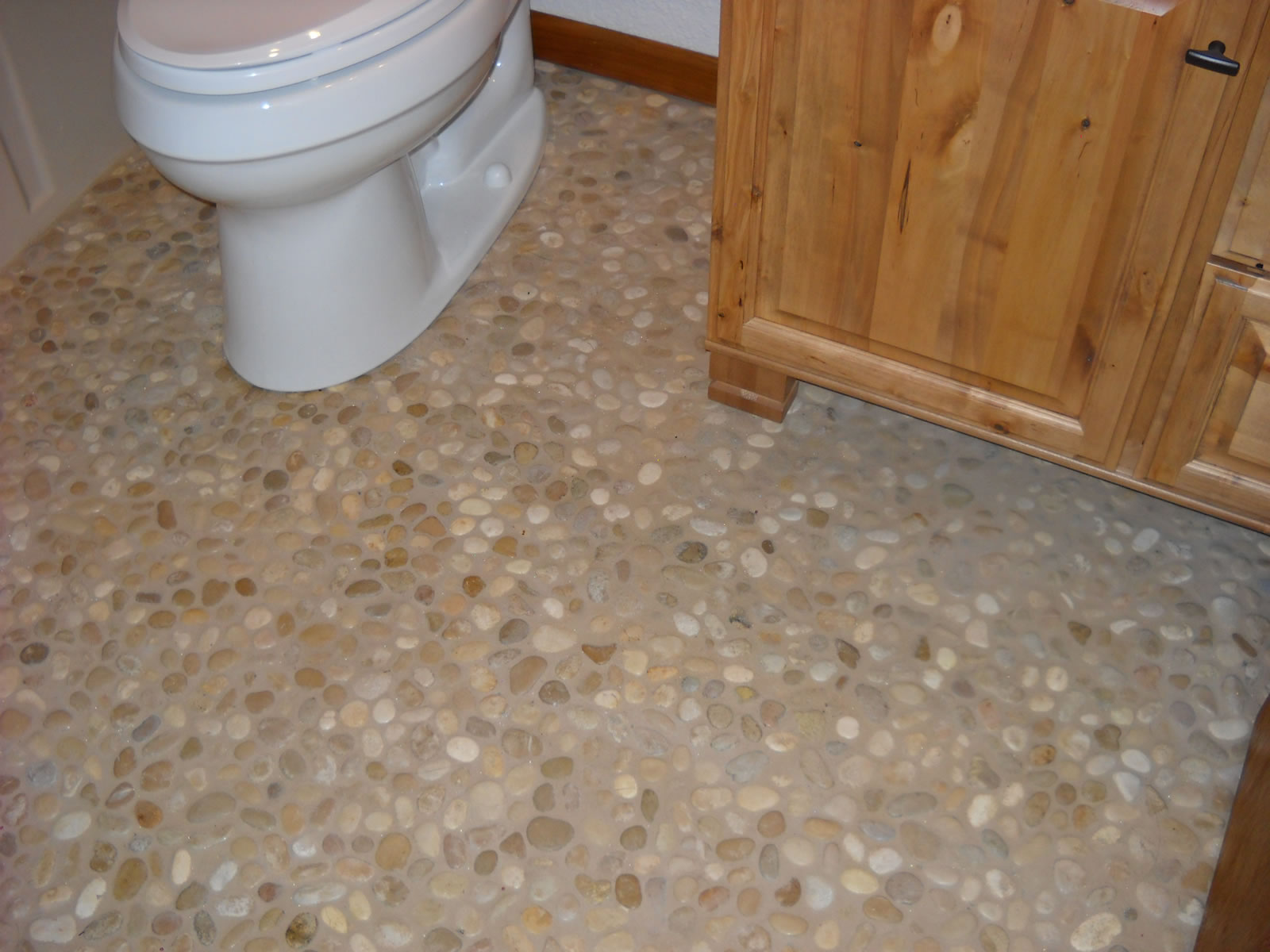 Pebble Tile Flooring Master Shower With Seat And Shelf
