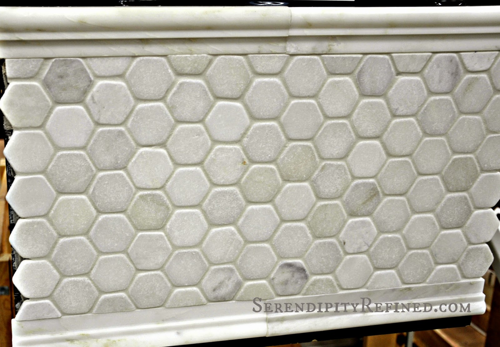 Honed hexagonal marble floor tile and marble molding