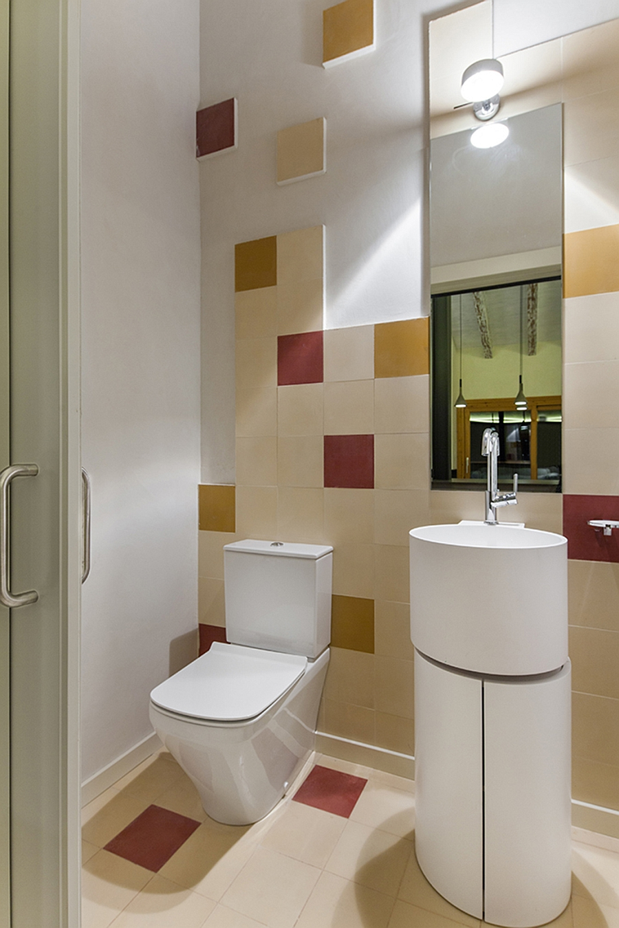Small-bathroom-with-fun-use-of-red-and-yellow-tiles