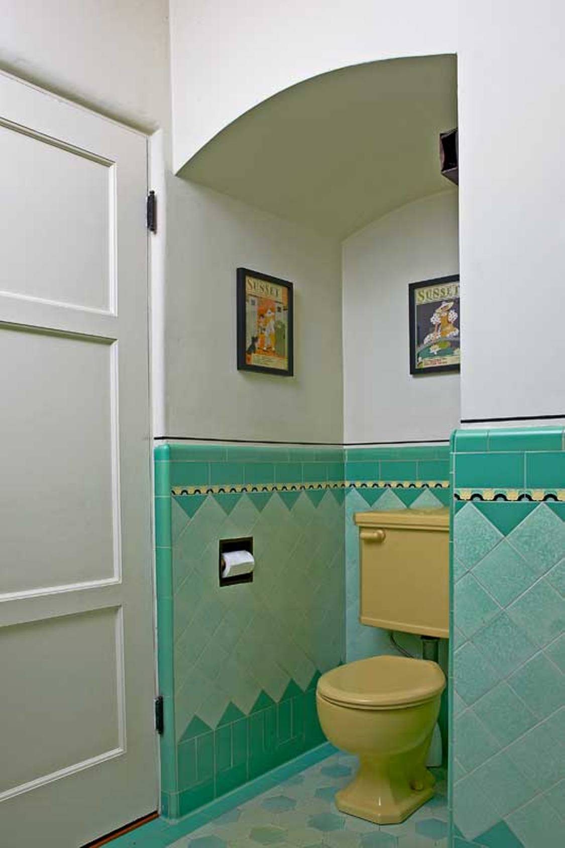 art-deco-bathroom-with-old-yellow-toilet-and-blue-tiles