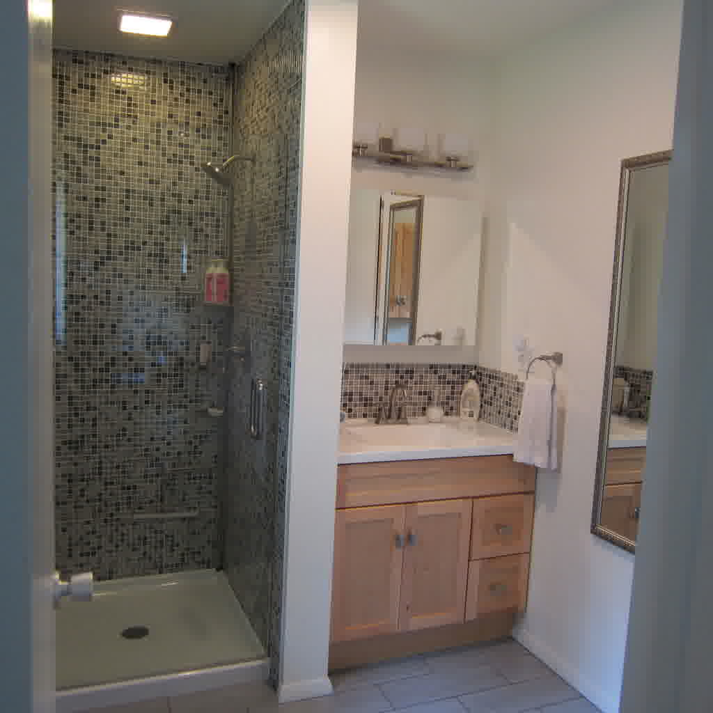 bathroom-bathroom-design-idea-with-shower-stall-designed-with-grey-mosaic-tile-wall-and-white-shower-pan-also-glass-door-and-chic-wall-lighting-combine-with-brown-wooden-kitchen-cabinet-designed-with