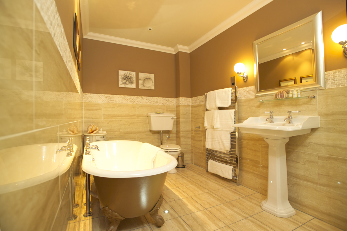 bathroom-brown-remodelling-bathroom-nuance-ideas-with-gloss-brown-clawfoot-tub-white-ceramic-sink-with-padestal-base-design-wall-marble-installation-with-small-stripes-tiles-decor-also-fancy-ball-sh