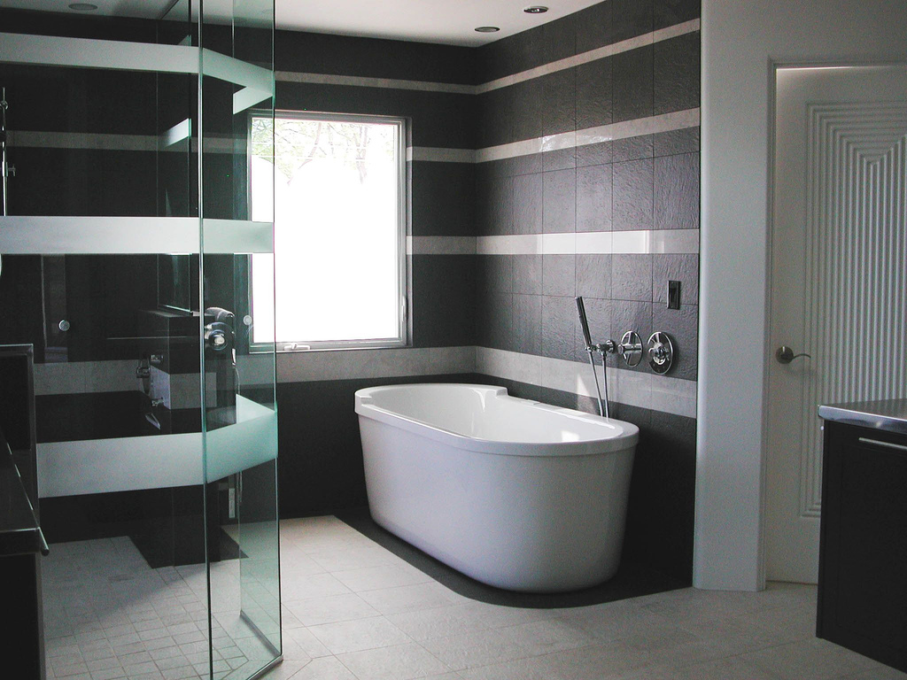 bathroom-elegant-black-and-white-bathroom-decoration-using-clear-glass-shower-door-including-black-high-end-bathroom-tile-and-oval-white-ceramic-free-standing-bathtub-interactive-high-end-tile-bathro