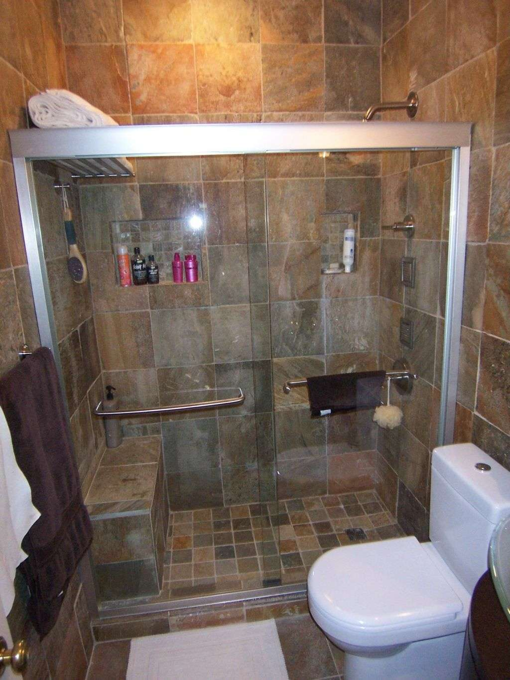 bathroom-fancy-design-ideas-using-white-toilets-and-rectangular-glass-shower-doors-also-with-silver-towel-bars-and-brown-tile-backsplash-endearing-bathrooms-look-using-shower-designs-with-bench