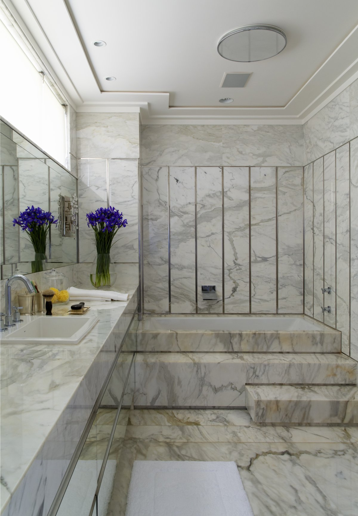 bathroom-high-end-bathroom-designs-with-elegant-bathroom-design-also-oval-white-ceramic-bathtub-with-white-marble-tub-platform-and-square-white-ceramic-sink-high-end-bathroom-designs