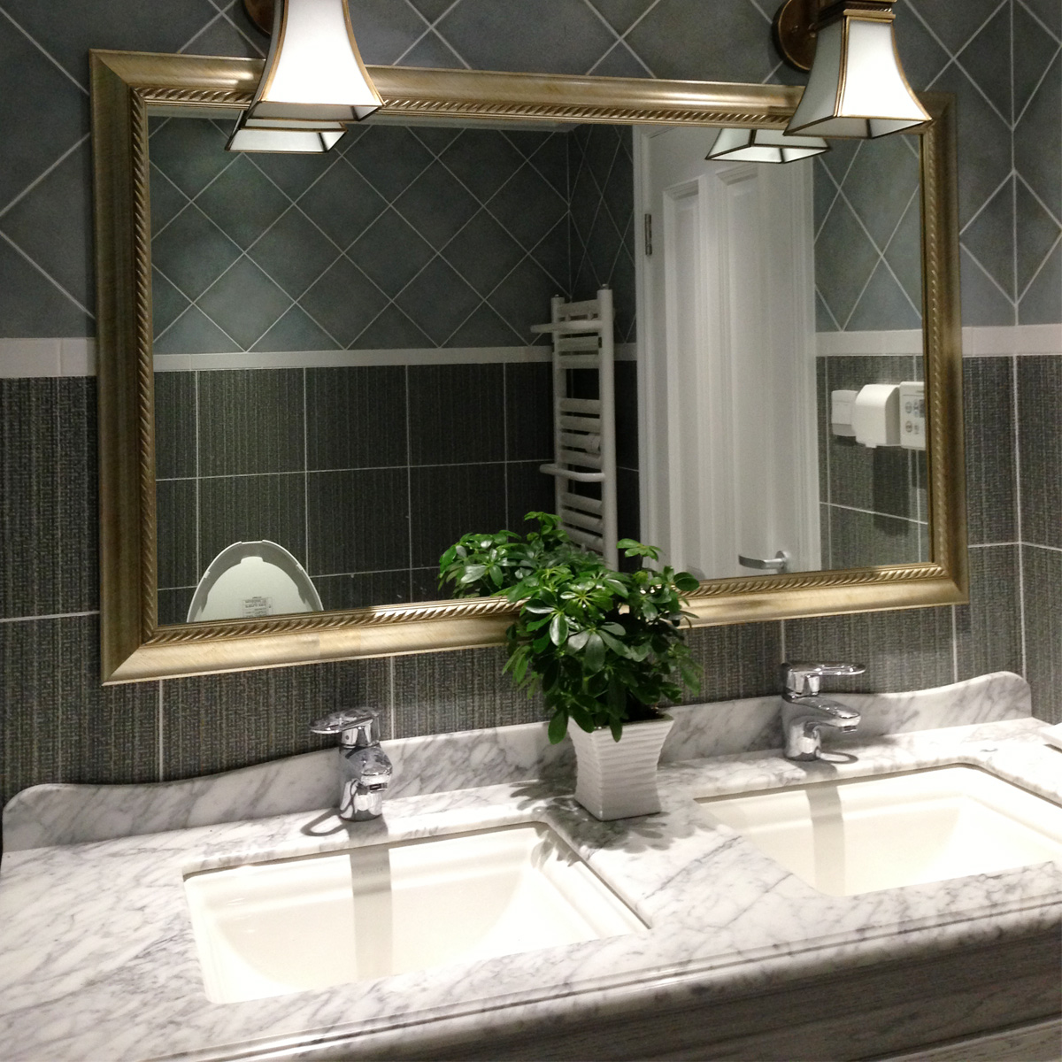 bathroom-modern-luxury-bathroom-decoration-with-brown-rectangular-mirror-frame-plus-wall-lamp-combine-with-black-tile-floor-and-white-granite-top-of-bathroom-cabinet-also-white-deep-sinks-cool-mirror