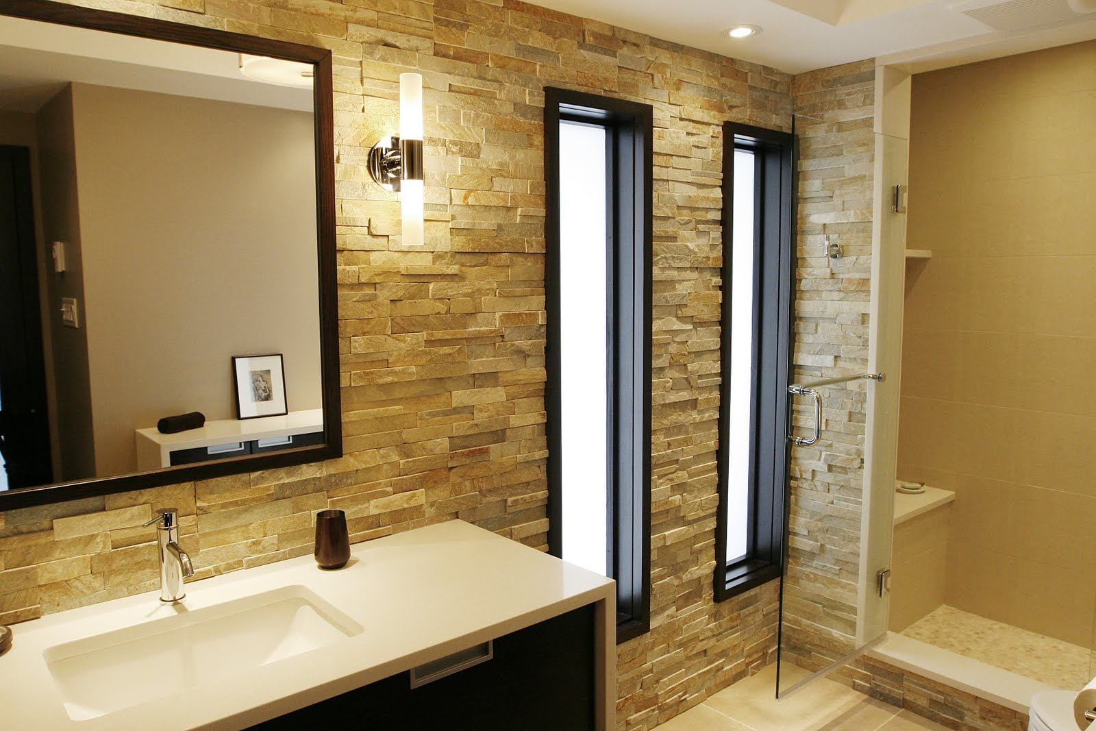 bathroom-rustic-modern-bathroom-design-with-beige-natular-stone-brick-wall-complete-with-shower-room-and-bathroom-cabinet-with-white-washbasin-plus-rectangular-mirror-and-wall-light-beige-bathroom-de
